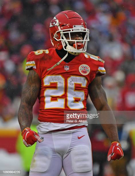 Running back Damien Williams of the Kansas City Chiefs reacts after rushing for a first down during the first half of the AFC Divisional Round...