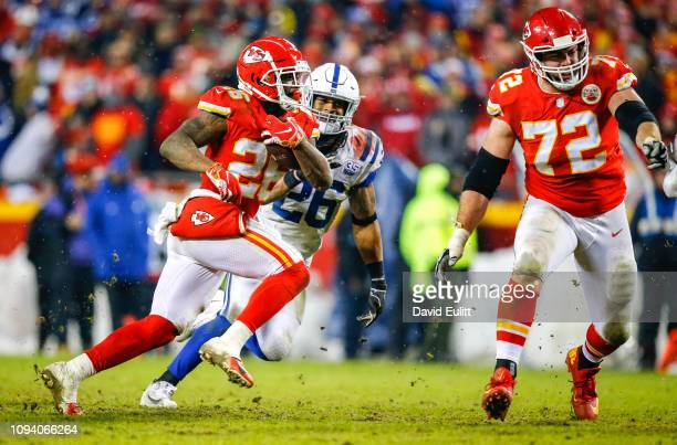 Running back Damien Williams of the Kansas City Chiefs runs past strong safety Clayton Geathers of the Indianapolis Colts in the AFC Divisional...