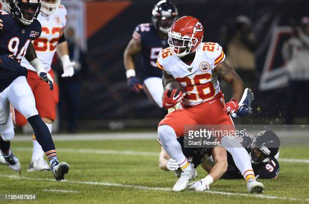 Running back Damien Williams of the Kansas City Chiefs runs the ball as he is tackled by outside linebacker Leonard Floyd of the Chicago Bears in the...