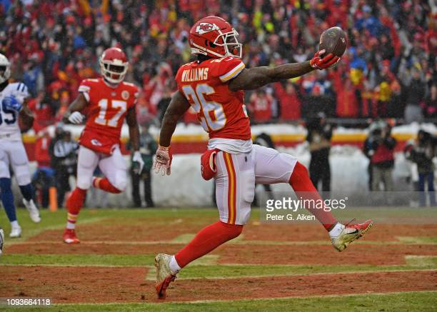 Running back Damien Williams of the Kansas City Chiefs rushes into the end zone for a touchdown during the first half of the AFC Divisional Round...