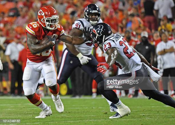 Running back Damien Williams of the Kansas City Chiefs rushes up field during the second half against defensive back Kurtis Drummond of the Houston...