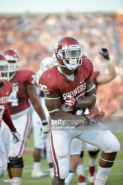 Running back Damien Williams of the Oklahoma Sooners holds the ball during the game against the West Virginia Mountaineers on September 7 2013 at the...