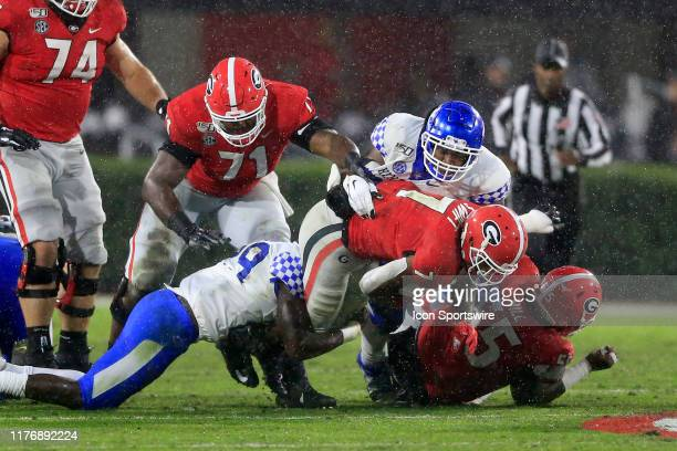 Running back D'Andre Swift of the Georgia Bulldogs is brought down by the Kentucky defense during the SEC football game between the Georgia Bulldogs...