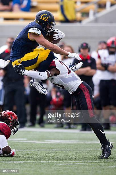 Running back Daniel Lasco of the California Golden Bears is tackled by defensive back Damontae Kazee of the San Diego State Aztecs during the first...