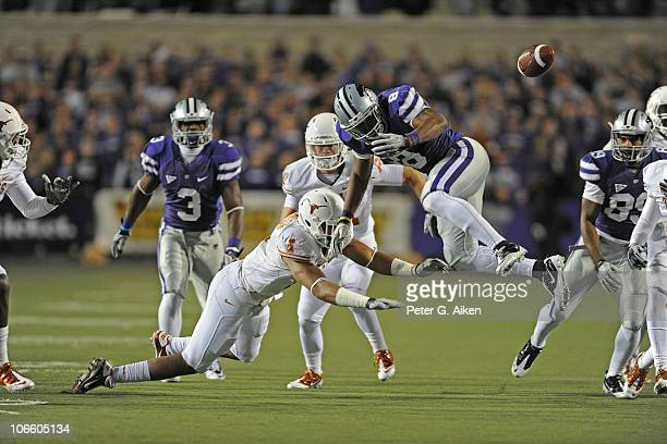 Running back Daniel Thomas of the Kansas State Wildcats fumbles the ball out of bounds after getting hit by linebacker Keenan Robinson of the Texas...