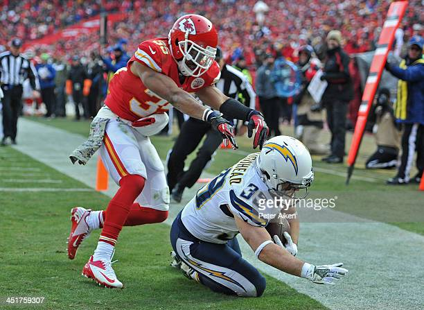 Running back Danny Woodhead of the San Diego Chargers scores a touchdown against safety Quintin Demps of the Kansas City Chiefs during the first half...