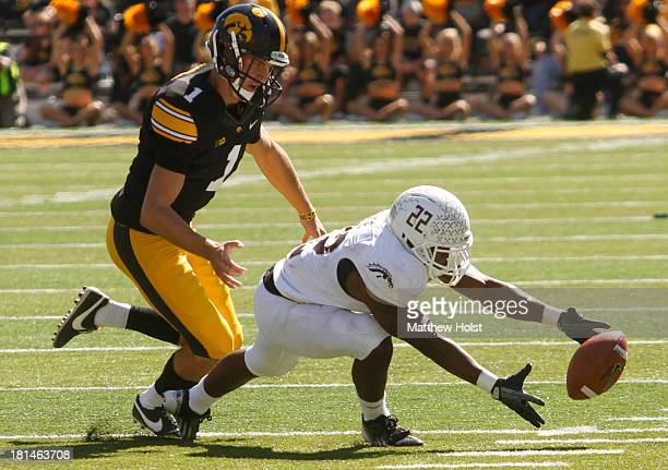 Running back Dareyon Chance of the Western Michigan Broncos recovers a fumble during the fourth quarter in front of place kicker Marshall Koehn of...