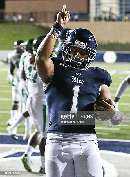 Running back Darik Dillard of the Rice Owls reacts after rushing for a touchdown against the North Texas Mean Green in overtime at Rice Stadium on...