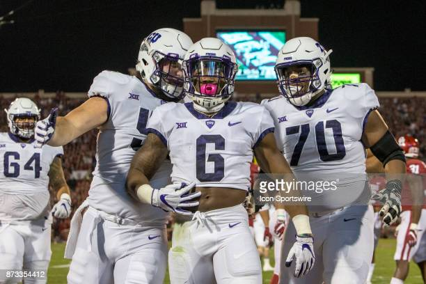 Running back Darius Anderson of the TCU Horned Frogs celebrates his touchdown with guard Cordel Iwuagwu of the TCU Horned Frogs during the Oklahoma...