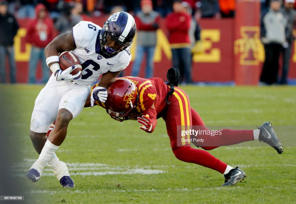 Running back Darius Anderson #6 of the TCU Horned Frogs is tackled by defensive back Evrett Edwards #4 of the Iowa State Cyclones as he rushed for yards in the second half of play at Jack Trice Stadium on October 28, 2017 in Ames, Iowa. The Iowa State Cyclones won 14-7 over the TCU Horned Frogs.