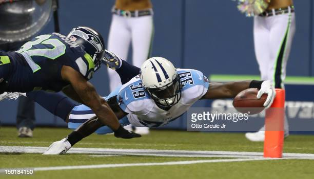 Running back Darius Reynaud of the Tennessee Titans rushes for a touchdown against Jeron Johnson of the Seattle Seahawks at CenturyLink Field on...
