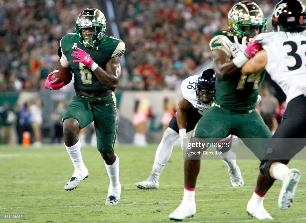 Running back Darius Tice #6 of the South Florida Bulls runs the ball into the red zone in the third quarter of their game against the Cincinnati Bearcats at Raymond James Stadium on October 14, 2017 in Tampa, Florida.