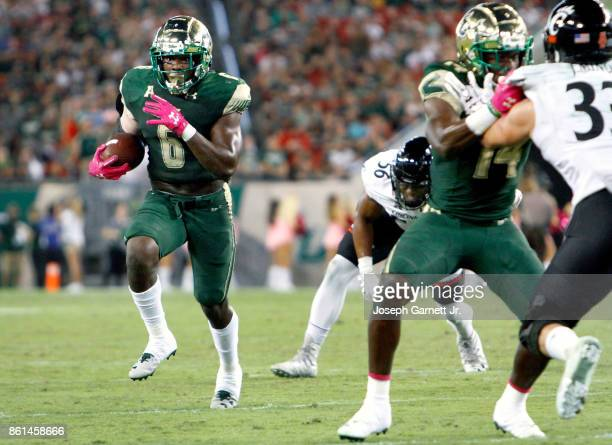 Running back Darius Tice of the South Florida Bulls runs the ball into the red zone in the third quarter of their game against the Cincinnati...