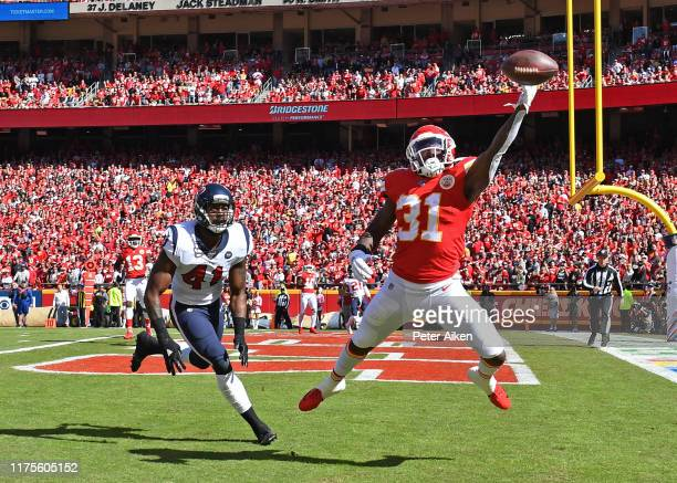Running back Darrel Williams of the Kansas City Chiefs makes a leaping attempt for a pass in the end zone against inside linebacker Zach Cunningham...