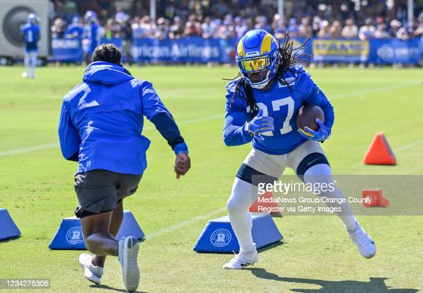 Running back Darrell Henderson Jr. Works out during the first day of training camp for the Los Angeles Rams in Irvine, CA, on Wednesday, July 28,...