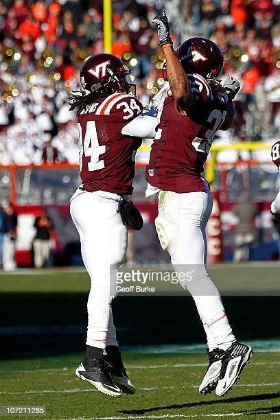Running back Darren Evans of the Virginia Tech Hokies celebrates with running back Ryan Williams of the Virginia Tech Hokies after scoring a...