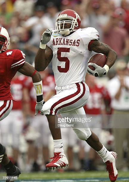Running back Darren McFadden of the Arkansas Razorbacks runs for a long gain in the first quarter against the Wisconsin Badgers in the Capitol One...