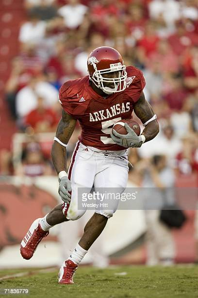 Running back Darren McFadden of the Arkansas Razorbacks runs with the ball during a game against the Utah State Aggies on September 9 2006 at Donald...