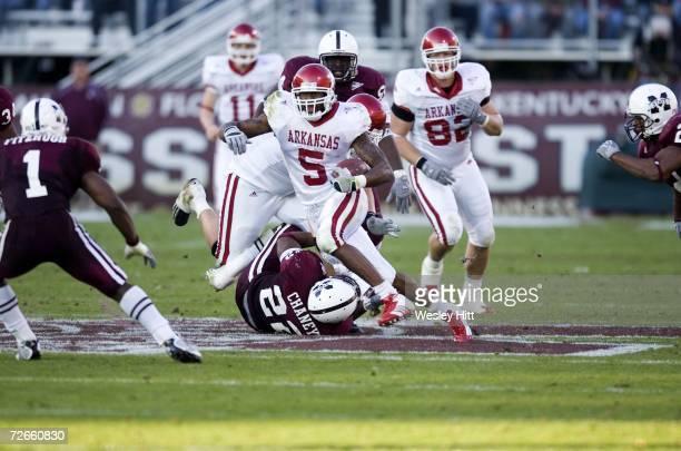Running back Darren McFadden of the Arkansas Razorbacks runs with the ball against the Mississippi State Bulldogs at Davis Wade Stadium on November...