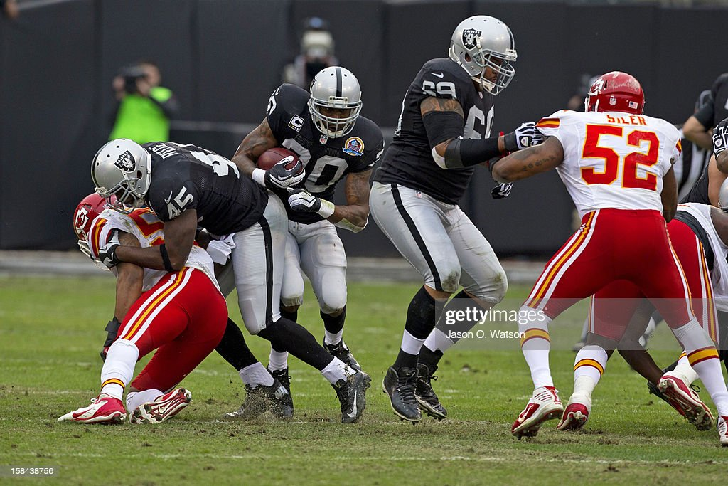 Running back Darren McFadden #20 of the Oakland Raiders rushes up field against the Kansas City Chiefs during the first quarter at O.co Coliseum on December 16, 2012 in Oakland, California.