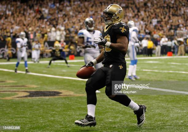 Running back Darren Sproles of the New Orleans Saints scores a touchdown against the Detroit Lions in the fourth quarter at MercedesBenz Superdome on...