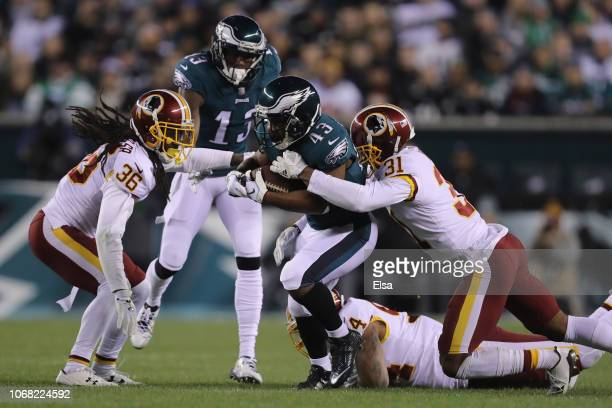 Running back Darren Sproles of the Philadelphia Eagles carries the ball against cornerback Fabian Moreau of the Washington Redskins during the second...