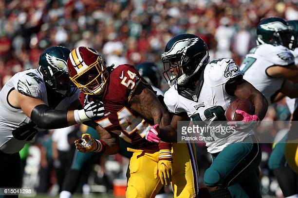 Running back Darren Sproles of the Philadelphia Eagles carries the ball against inside linebacker Mason Foster of the Washington Redskins in the...