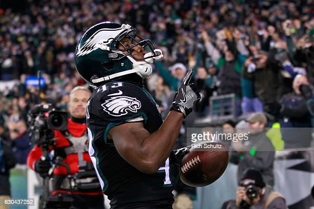 Running back Darren Sproles of the Philadelphia Eagles celebrates after scoring a touchdown against the New York Giants during the first quarter of...