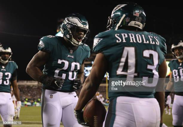 Running back Darren Sproles of the Philadelphia Eagles celebrates his touchdown with teammate running back Wendell Smallwood against the Washington...