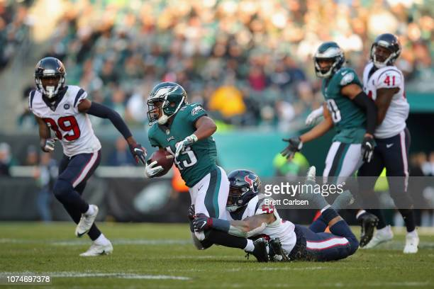 Running back Darren Sproles of the Philadelphia Eagles is tackled by inside linebacker Benardrick McKinney of the Houston Texans during the third...