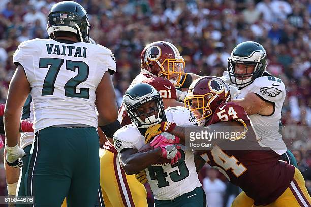 Running back Darren Sproles of the Philadelphia Eagles is tackled by inside linebacker Mason Foster of the Washington Redskins in the fourth quarter...