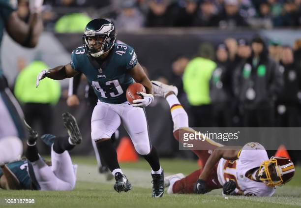 Running back Darren Sproles of the Philadelphia Eagles returns the punt against wide receiver Jehu Chesson of the Washington Redskins during the...