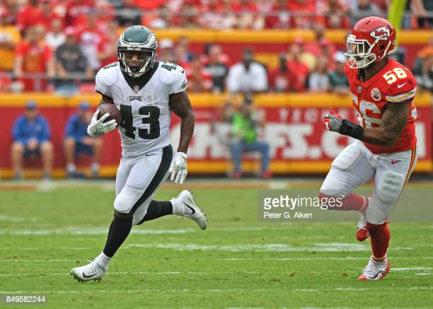 Running back Darren Sproles of the Philadelphia Eagles runs up field against linebacker Derrick Johnson of the Kansas City Chiefs during the second...