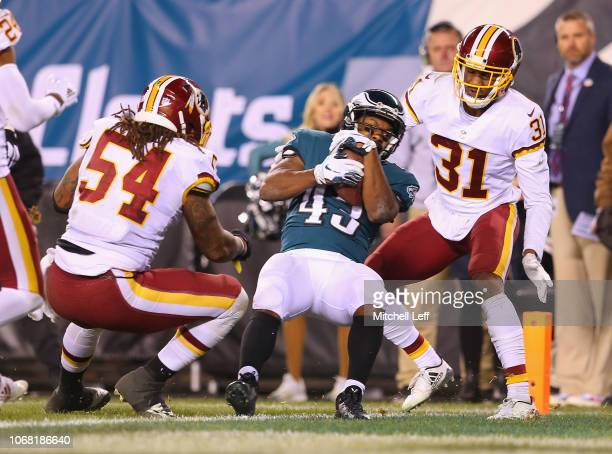 Running back Darren Sproles of the Philadelphia Eagles scores a touchdown against cornerback Fabian Moreau and linebacker Mason Foster of the...