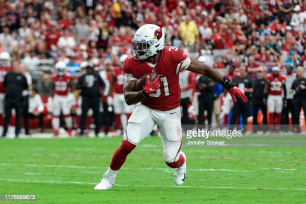 Running back David Johnson of the Arizona Cardinals carries the ball in the NFL game against the Carolina Panthers at State Farm Stadium on September...