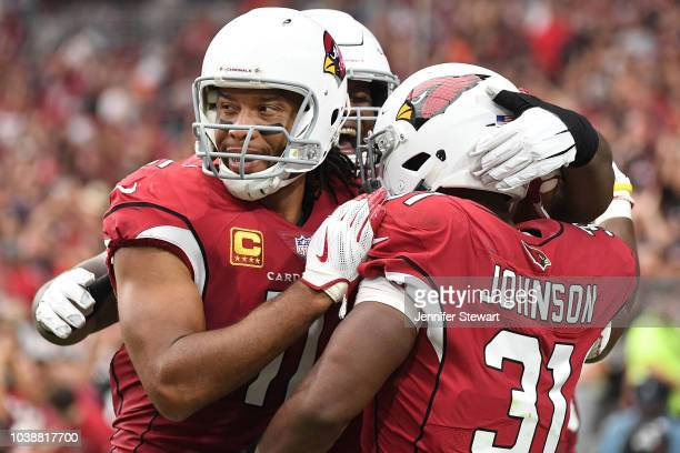 Running back David Johnson of the Arizona Cardinals celebrates a 21 yard touchdown with wide receiver Larry Fitzgerald in the first half of the NFL...