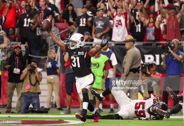 Running back David Johnson of the Arizona Cardinals celebrates after catching a 14 yard touchdown against outside linebacker De'Vondre Campbell of...