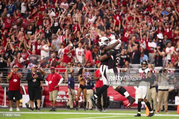 Running back David Johnson of the Arizona Cardinals celebrates with Trent Sherfield after catching a 14 yard touchdown against the Atlanta Falcons...