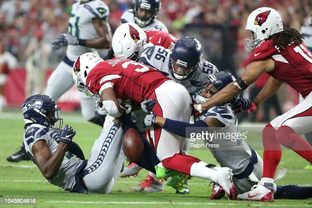 Running back David Johnson of the Arizona Cardinals fumbles after being hit by linebacker Mychal Kendricks cornerback Tre Flowers and defensive back...