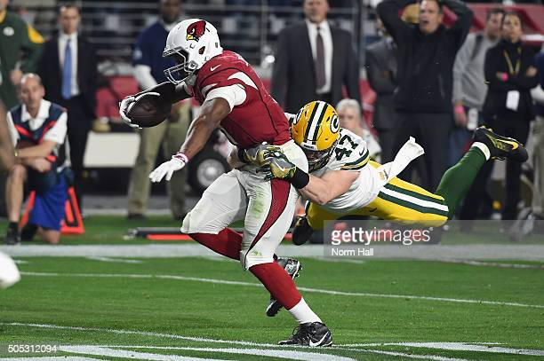 Running back David Johnson of the Arizona Cardinals is hit by inside linebacker Jake Ryan of the Green Bay Packers during the first quarter of the...