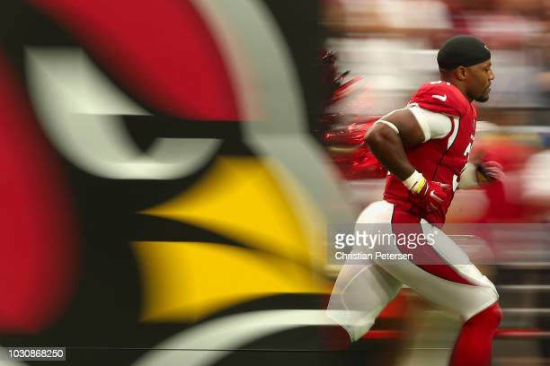 Running back David Johnson of the Arizona Cardinals runs onto the field during introductions to the NFL game against the Washington Redskins at State...