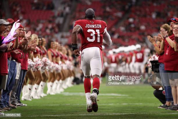 Running back David Johnson of the Arizona Cardinals runs out to the NFL preseason game against the Oakland Raiders at State Farm Stadium on August 15...
