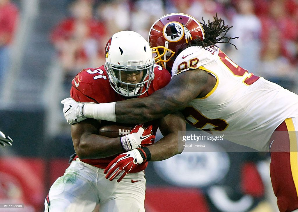 Running back David Johnson #31 of the Arizona Cardinals runs the ball as he is tackled by Ricky Jean Francois #99 of the Washington Redskins during the second quarter of a game at University of Phoenix Stadium on December 4, 2016 in Glendale, Arizona. The Cardinals defeated the Redskins 31-23.