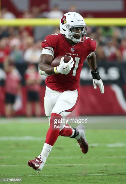 Running back David Johnson of the Arizona Cardinals runs with the ball during an NFL game against the Seattle Seahawks at State Farm Stadium on...