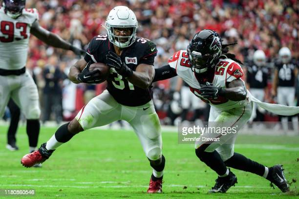 Running back David Johnson of the Arizona Cardinals runs with the ball against outside linebacker De'Vondre Campbell of the Atlanta Falcons in the...