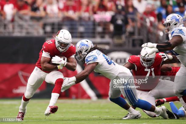 Running back David Johnson of the Arizona Cardinals rushes against linebacker Jalen Reeves-Maybin of the Detroit Lions in the first quarter of the...