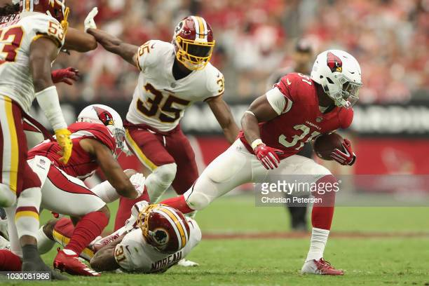 Running back David Johnson of the Arizona Cardinals rushes the football past defensive back Montae Nicholson and cornerback Fabian Moreau of the...