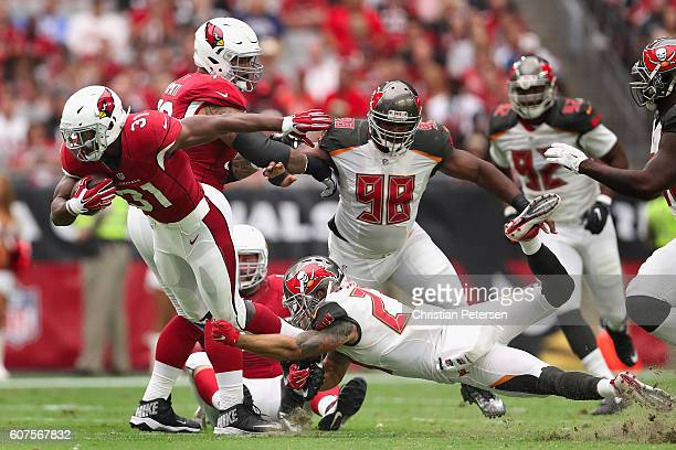 Running back David Johnson of the Arizona Cardinals rushes the football past strong safety Chris Conte of the Tampa Bay Buccaneers during the second...