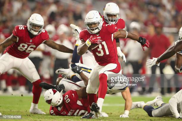 Running back David Johnson of the Arizona Cardinals rushes the football against the Los Angeles Chargers during the first half of the preseason NFL...