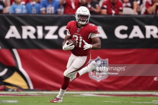 Running back David Johnson of the Arizona Cardinals rushes the football against the Detroit Lions during the first half of the NFL game at State Farm...